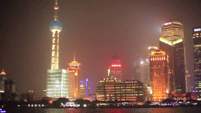 pudong city and huangpu river at night - river huangpu stock videos & royalty-free footage