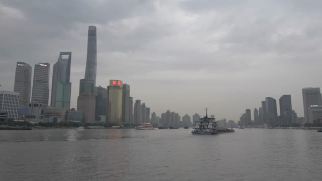 pudong skyline and huangpu river from the bund at dusk, shanghai, people's republic of china, asia - oriental pearl tower shanghai stock videos & royalty-free footage