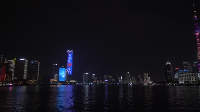 pudong skyline and huangpu river from the bund at night, shanghai, people's republic of china, asia - oriental pearl tower shanghai stock videos & royalty-free footage