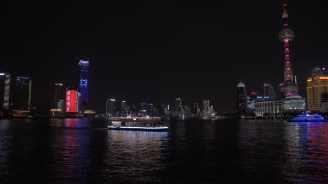 pudong skyline, illuminated cruise boat and huangpu river from the bund at night, shanghai, people's republic of china, asia - oriental pearl tower shanghai stock videos & royalty-free footage