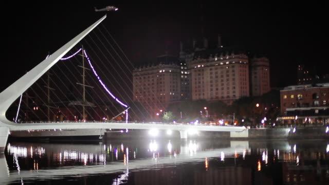 puente de la mujer footbridge illuminated at night puerto madero buenos aires argentina - puente de la mujer stock videos & royalty-free footage