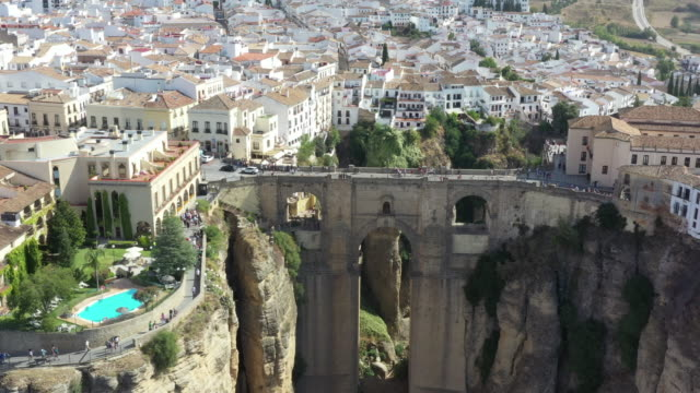puente nuevo between the canyon and nearby village / ronda, spain - cross section stock videos & royalty-free footage