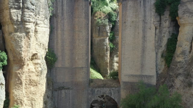 puente nuevo between the canyon and nearby village / ronda, spain - steep stock videos & royalty-free footage