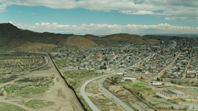 puerto de anapra, ciudad juárez and us/mexico border wall near el paso - aerial - geographical border stock videos & royalty-free footage