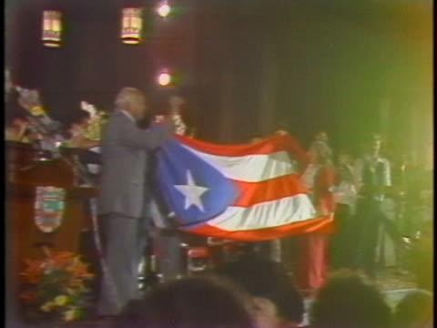 puerto rican nationalist lolita lebron unfurls a puerto rican flag with irvin flores, andres figueroa cordero and rafael cancel miranda during a... - puerto rican ethnicity stock videos & royalty-free footage
