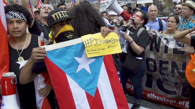 puerto ricans in columbus circle nyc rally in solidarity with the puerto rican protestors in puerto rico demanding that the governor of puerto rico... - columbus circle stock videos & royalty-free footage