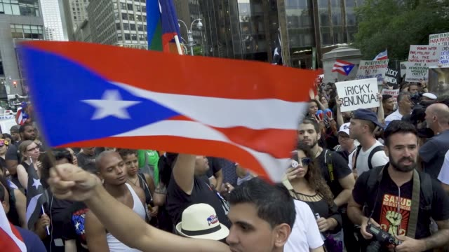 puerto ricans in columbus circle nyc rally in solidarity with the puerto rican protestors in puerto rico demanding that the governor of puerto rico... - puerto rican ethnicity stock videos & royalty-free footage