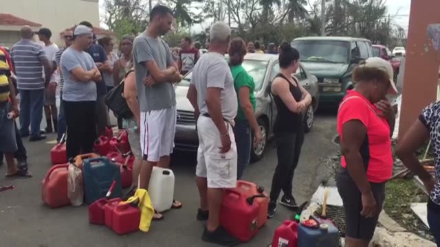 Puerto Ricans wait in long queues for gasoline and groceries on Saturday in San Juan as authorities on the island rushed to evacuate tens of...