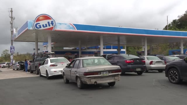 Puerto Ricans waited in long lines at gas stations in Rio Grande as islanders scrambled Monday to board up windows and get last minute supplies as a...