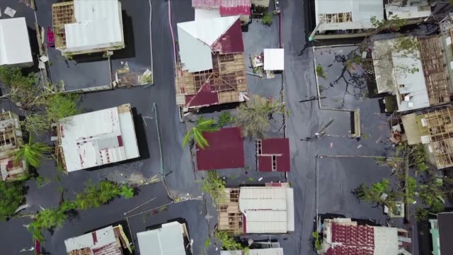 vídeos de stock, filmes e b-roll de puerto rico battles dangerous floods after hurricane maria ravaged the island as rescuers race against time to reach residents trapped in their homes... - porto riquenho