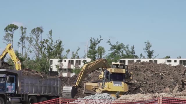 guaynabo puerto rico december 2017 ongoing work at the debris removal site in los alamos guaynabo usace has been collaborating on debris removal in... - bulldozer stock videos & royalty-free footage