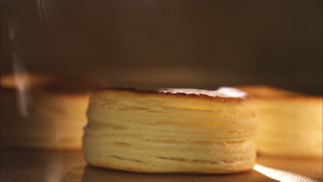 puff pastry rising in oven - proofing baking technique stock videos and b-roll footage