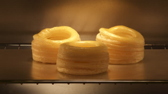 puff pastry rising in oven. - baked stock videos & royalty-free footage