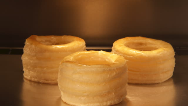 puff pastry rising in oven. - puff pastry stock videos & royalty-free footage