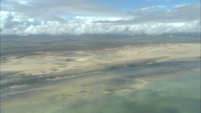 puffy clouds drift through the sky above shark bay in western australia. - western australia bildbanksvideor och videomaterial från bakom kulisserna