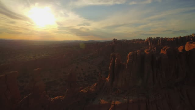 Pull back aerial shot through The Soldiers at The Arches National Park