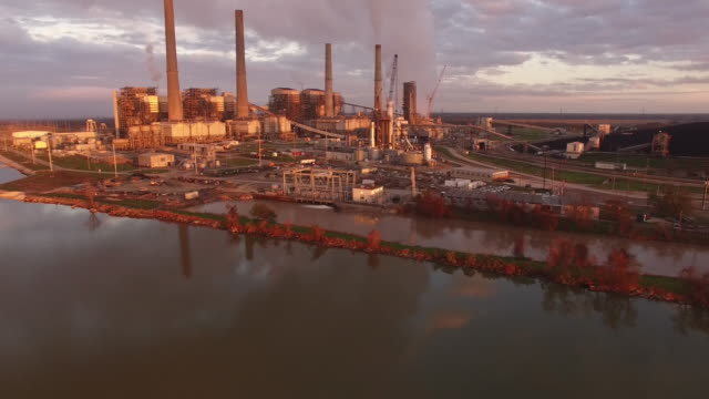 pull back birds flying under power plant, drone 4k industry aerial video, power plant coal, natural gas, wind farm, renewable energy, smokestack, - coal fired power station stock videos and b-roll footage