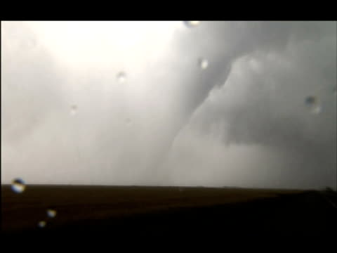 stockvideo's en b-roll-footage met pull back from 'elephant trunk' tornado on ground kansas - neus van een dier