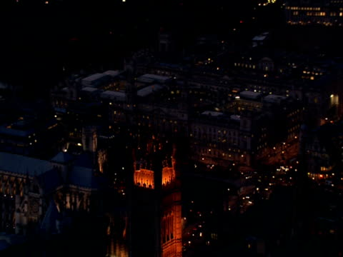 Pull back from Victoria Tower to reveal Houses of Parliament illuminated at night