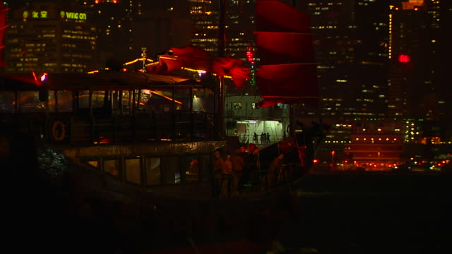 pull back night shot ferry in aberdeen harbour hong kong kwangtung china - aberdeen hong kong stock videos & royalty-free footage