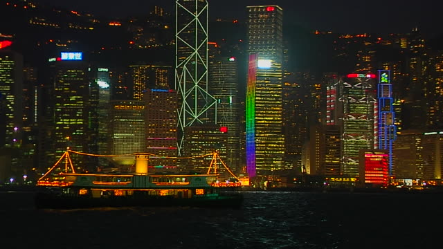 pull back night shot skyline aberdeen harbour hong kong kwangtung china - aberdeen hong kong stock videos & royalty-free footage