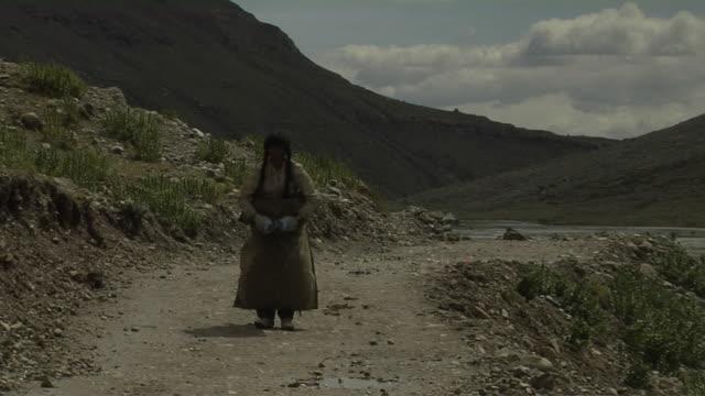 Pull Back Reveal Block Shot Pilgrim Performing Circumambulation Lhasa Tibet China