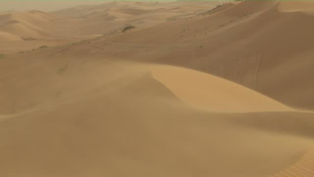 pull back shot desert muscat oman - oman stock-videos und b-roll-filmmaterial