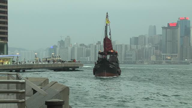 pull back shot ferry in aberdeen harbour hong kong kwangtung china - aberdeen hong kong stock videos & royalty-free footage