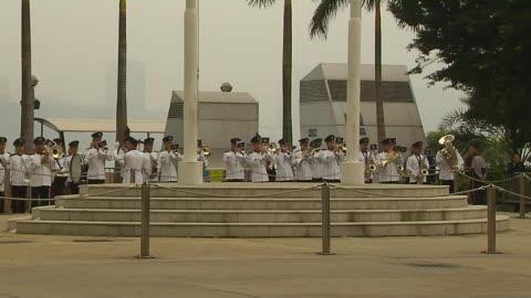 pull back shot flag hoisting hong kong china - hoisting stock videos & royalty-free footage