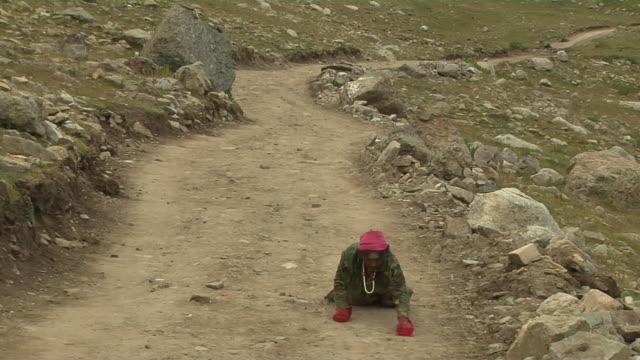 pull back shot pilgrim performing circumambulation lhasa tibet china  - pilgrim stock videos & royalty-free footage