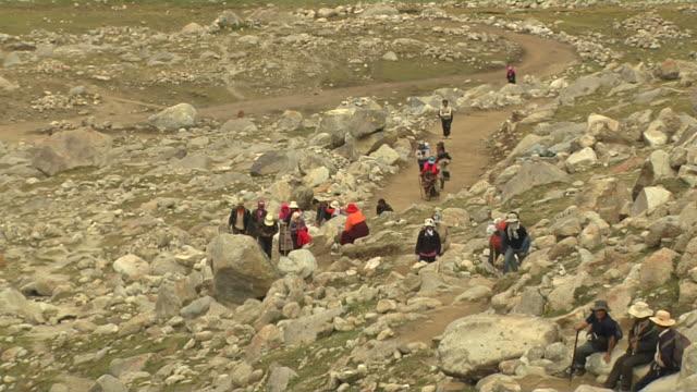 pull back shot pilgrims doing circumambulation around mount kailash lhasa tibet china - pilgrim stock videos & royalty-free footage