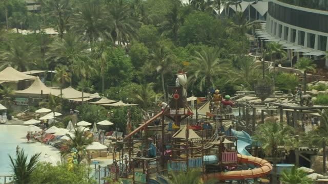 pull back shot wild wadi dubai united arab emirates - amusement park stock videos & royalty-free footage