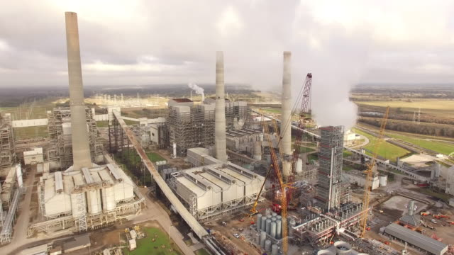 pull back side view of power plant, drone 4k industry aerial video, power plant coal, natural gas, wind farm, renewable energy, smokestack, - coal fired power station stock videos and b-roll footage