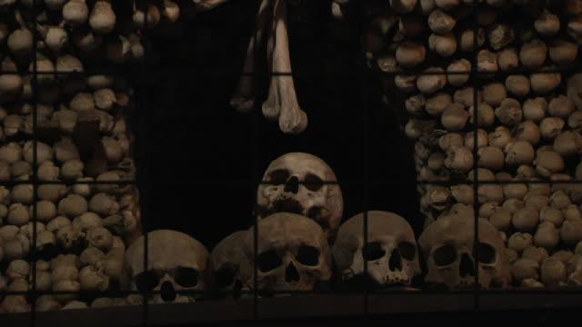 pull back skull bone church kutna hora czech republic - czech republic stock videos & royalty-free footage
