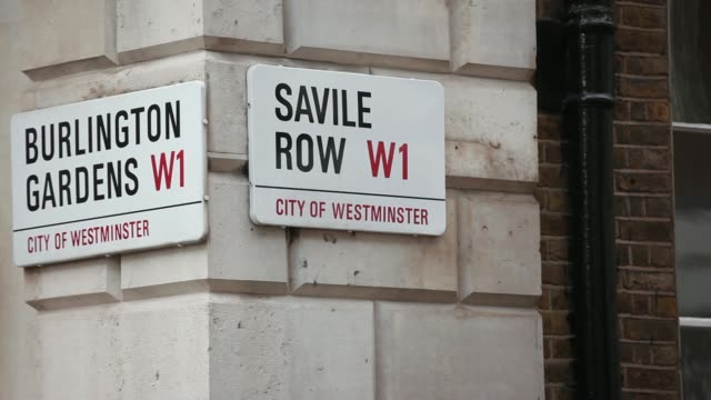 pull focus a plaque reading no 1 savile row sits on a commercial real estate building that forms part of the pollen estate in london uk on monday aug... - savile row stock videos and b-roll footage