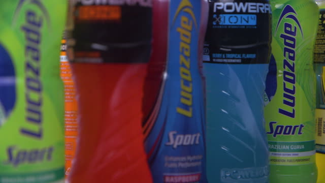 pull focus across a line of lucozade and powerade sports drink bottles fkad630p clip taken from programme rushes abqa623f - medium group of objects stock videos & royalty-free footage