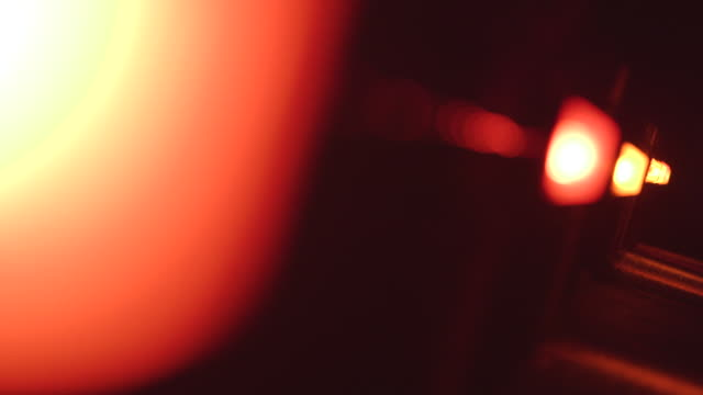 pull focus across a row of red lights on a wall - warning sign stock videos & royalty-free footage