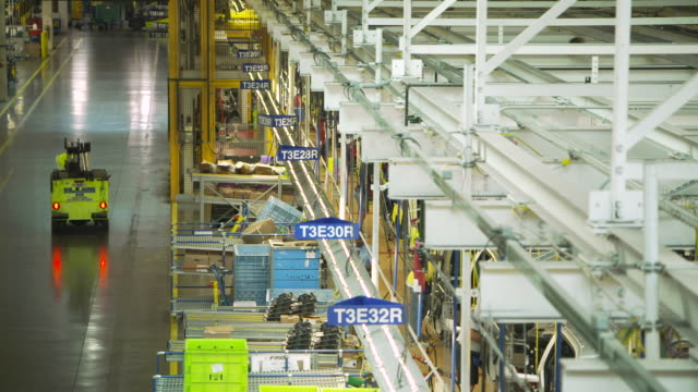 pull focus along a production line at the ford river rouge complex in dearborn, michigan, usa. - golf cart stock videos & royalty-free footage