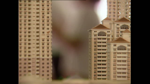 pull focus architectural model to building site in kuala lumpur; 1996 - 1996 stock videos & royalty-free footage