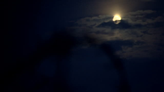 pull focus between atmospheric clouds moving across the moon and looped barbed wire, france. - war and conflict stock videos & royalty-free footage