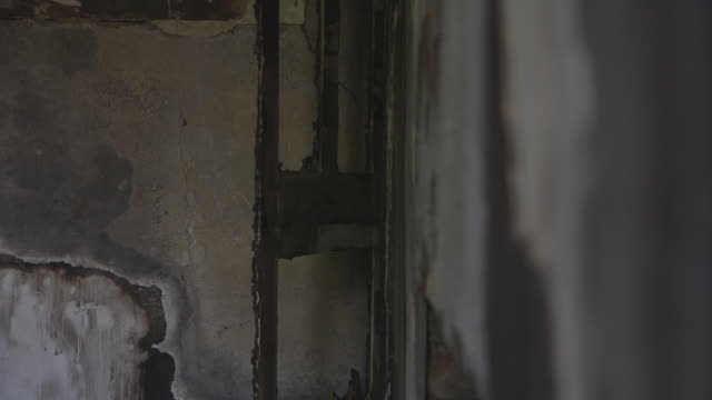 pull focus between charred door and damaged wall - damaged stock videos & royalty-free footage