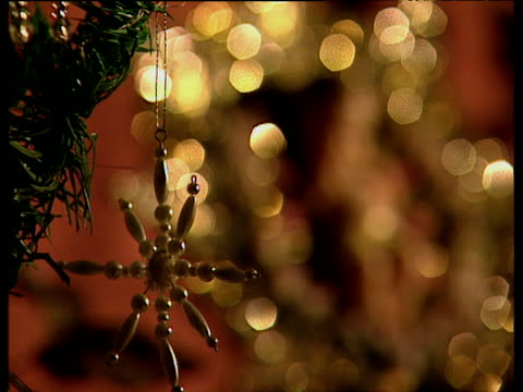 Pull focus Christmas tree to ornamental decoration depicting baby Jesus
