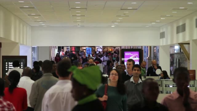 pull focus crowds of shoppers walking through sandton city shopping center in johannesburg, south africa, on thursday, dec. 12 various general views... - ハウテング州点の映像素材/bロール