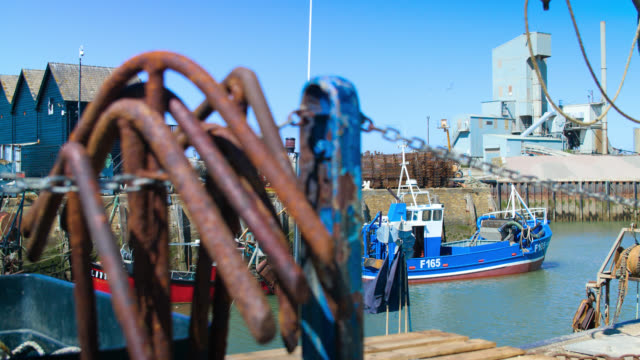 pull focus from boat to rusty anchors in harbour - weathered stock videos & royalty-free footage