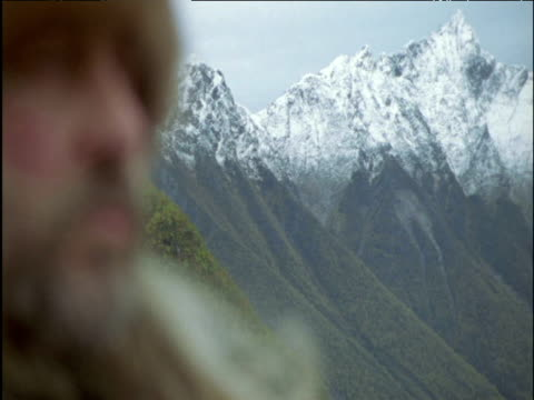 pull focus from mountains to face of viking norway - viking stock videos and b-roll footage