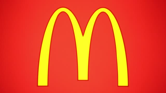 pull focus into mcdonald's golden arches logo pull focus out of mcdonald's golden arches logo a beverage cup and large fries stand in the foreground... - carton stock videos & royalty-free footage