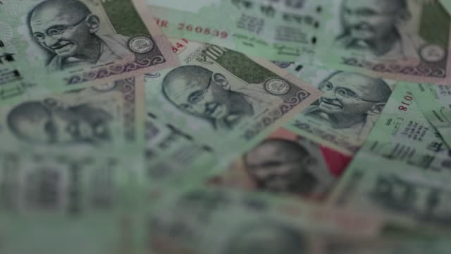 pull focus mcs into indian one hundred rupee banknotes mcs quick pan r l of indian five hundred and one thousand rupee banknotes mcs pull focus and... - financial accessory stock videos & royalty-free footage
