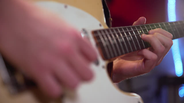 pull focus of a solo being played on an electric guitar - guitar stock videos & royalty-free footage