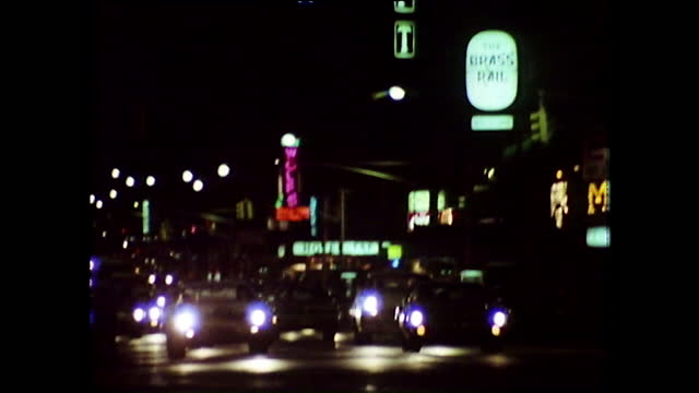 pull focus of cars and lit signs in times square at night; 1974 - fade out video transition stock videos & royalty-free footage