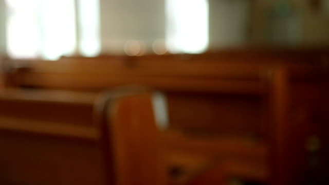 Pull focus of wooden church pews
